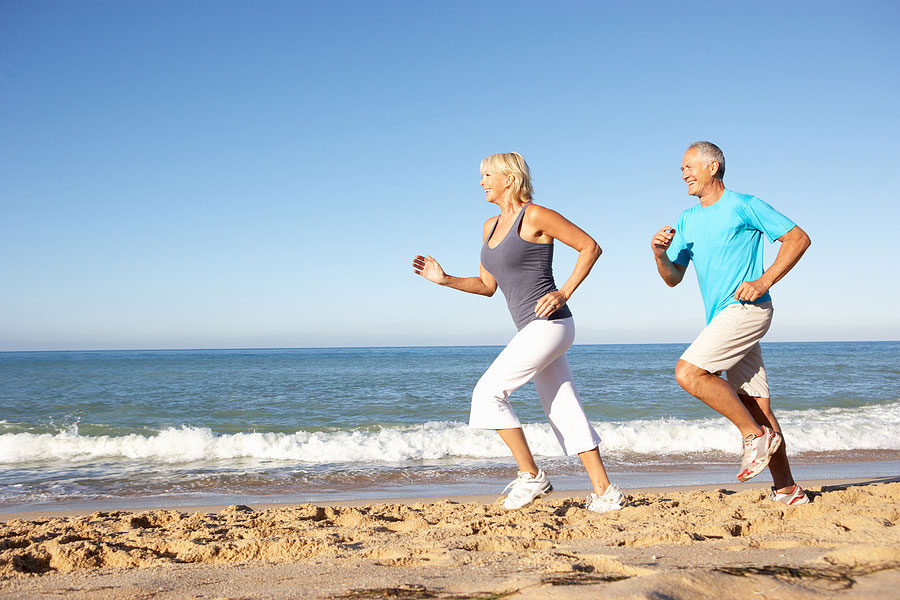 How Much HGH to Take a Day Older Couple Running on the Ocean Beach