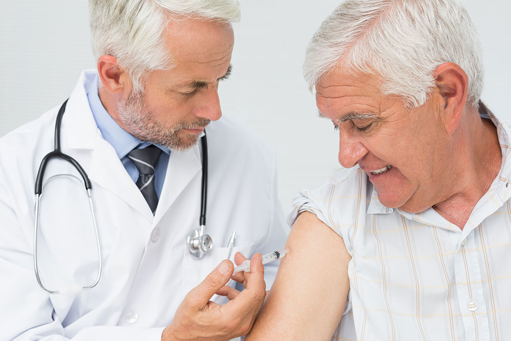 Buy Testosterone Injections a Grey Haired Man Receives an Injection