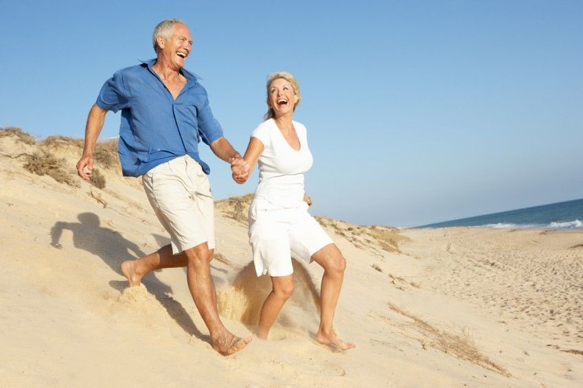 What Insurance Cover Testosterone Middle-Aged Couple Running On the Beach