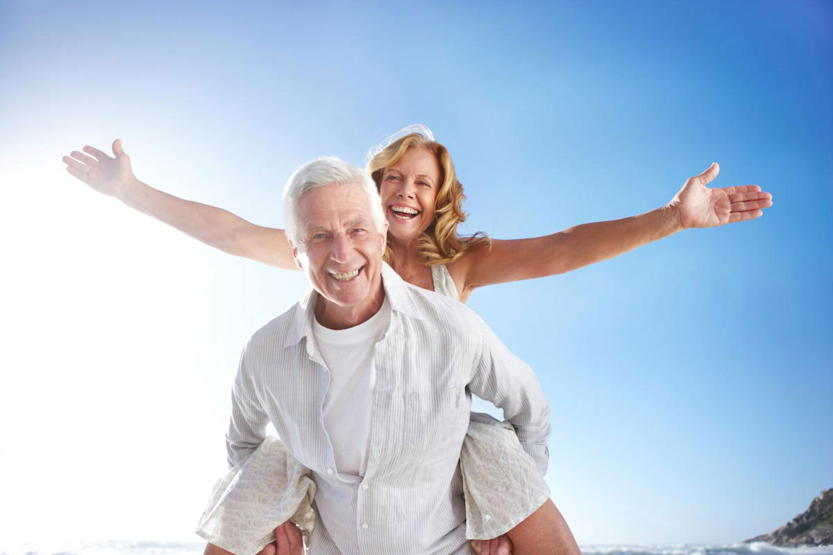 Testosterone Therapy Cost Per Month Happy Middle-Aged Couple